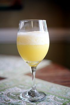 Blended Mimosas - Just orange juice and champagne with some blended with ice first and then topped up with more champagne - sounds lovely for summer!