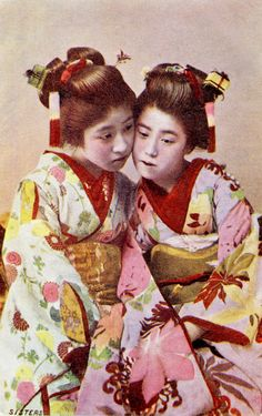 """Two Young Geisha with Cricket Cage Hairpins """"This postcard shows two Hangyoku (Young Geisha) wearing miniature Mushi Kago (Insect Cages) tied to tiny stands and attached to Kanzashi (Hair."""
