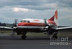 I photographed this Aspen Airways Convair CV-580 at the Salem airport in May 1980. This was George H.W. Bush's campaign plane during the 1980 presidential primary. I watched the plane come in, then I drove downtown to follow Bush as he walked through a huge crowd shaking hands and saying nothing important, then I beat his motorcade back to the airport to watch him leave. I shot this as the plane was getting ready to depart. Curiously, almost nobody was at the airport to watch him come and…
