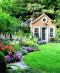 Cottage garden plants frame this curvaceous lawn and sensational summerhouse #gardens #CottageGarden