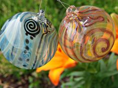 A personal favorite from my Etsy shop https://www.etsy.com/listing/400499159/handmade-lampwork-glass-garden-ornament
