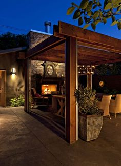 pergola sitting area with fireplace