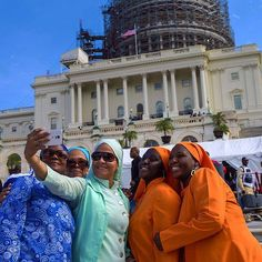 "From @washpostphoto ""Dare to love yourself as if you were a rainbow with gold at both ends."" Quotation by Aberjhani from  Journey through the Power of the Rainbow. Photo: Washington, DC - Oct 9, 2015 A group of colorfully clad women take a selfie in front of the U.S. Capitol on the day before the JUSTICE OR ELSE! RALLY held Saturday, October 10, 2015, at 10:00am on the National Mall in Washington, DC. The gathering was to demand justice and equality for all in the United States."