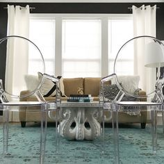 Interior Design | Sunroom | GrandinRoad Octopus Table | Clear Chairs | Black and White | cb2 apani Pillow | cb2 xbase Pillow | Turquoise Area Rug | Black Walls | Dipped Interiors