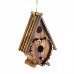 What's not to love about this rustic wooden birdhouse. A great country accent hanging from a tree branch or your porch that will make the birds a happy home. Rain-splitter roof Split log heart decoration 2 Entrances Durable fir wood construction x x BPT