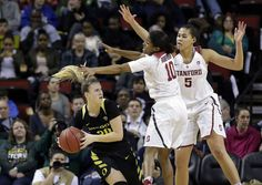 Stanford's Kaylee Johnson (5) and Briana Roberson (10) defend Oregon's Sabrina Ionescu during the second half of an NCAA college basketball game in the Pac-12 tournament, Saturday, March 4, 2017, in Seattle. (AP Photo/Elaine Thompson) Photo: Elaine Thompson, AP