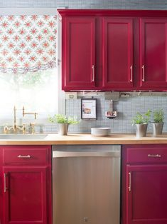 Small Kitchen Makeover: Bold Red Kitchen With Gadget Station >> http://www.hgtv.com/design/decorating/design-101/bold-kitchen-makeover-pictures?soc=pinterest