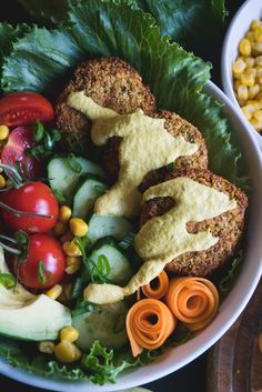 Healthy and delicious oven-baked falafel with vegan cashew cheese sauce.