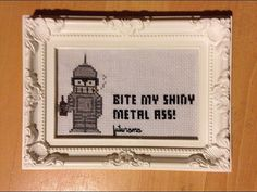 Hey, I found this really awesome Etsy listing at https://www.etsy.com/listing/216043097/futurama-cross-stitch-framed-bender-kiss