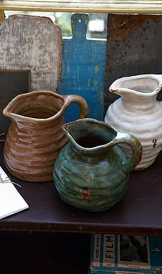Rustic hand thrown earthenware jugs, glazed with a deliberatedly distressed finish