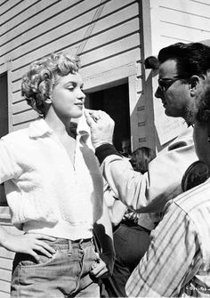 Whitey Snyder touches up Marilyn Monroe's make-up, on the set of Clash by Night, 1952.