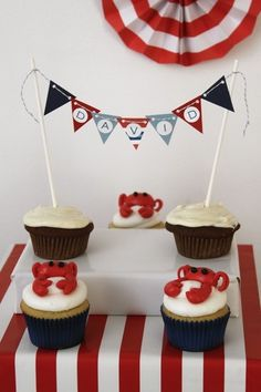 Nautical baby shower crab cupcakes. I like the little banner- could make one for the donut cake.