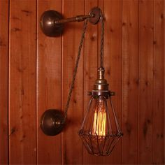 Inspired by century design, the Apoch Pulley Cage Wall Light sets an industrial tone with ease, a piece with vintage character and modern style. This industrial wall lamp will be an excellent addition to your home, office or workshop decor. Retro Lighting, Interior Lighting, Modern Lighting, Wall Lighting, Lighting Ideas, Vintage Wall Lights, Modern Wall Lights, Pulley Light, Decor Around Tv