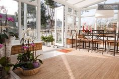 Conservatory /dining. Bright and enough space for all to sit .