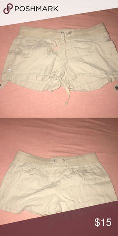 Beige shorts with a spandex drawstring waist Drawstring shows through medal clips in the back, there are also clips on the sides for an option of rolling up Shorts