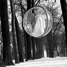 """American photographer Melvin Sokolsky shot these stunningly-surreal fashion photographs for Harper's Bazaar magazine in 1963. The """"Bubble Series"""" featured models in giant plastic bubbles, suspended above various locations"""