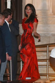 Clooney proved that black-tie doesn't have to mean a night of discomfort and a pinching strapless bra, opting for a flowy dress with an asymmetrical hemline. Gown, Alexander McQueen