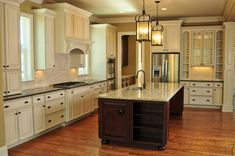 contemporary kitchen ideas Giallo Ornamental granite countertop white cabinets wood flooring lantern chandeliers