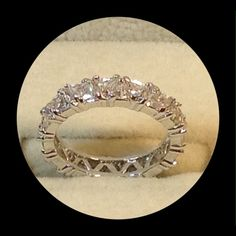 Cubic Zirconia Trillion Cut Eternity Ring This gorgeous Eternity Ring is composed of Top Quality Trillion Cut Cubic Zirconias set into Precious 925 Sterling Silver. This Spectacular Sparkler shines like diamonds! There are no flaws in this one,❤️❤️❤️ Jewelry Rings