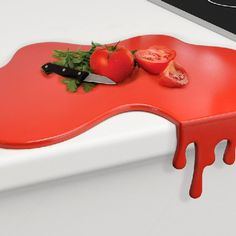 """Splash Red Kitchen Cutting Board - pair this with the splash spoon rest and """"The Ex"""" knife holder and you've got an awesomely bloody themed kitchen! Oh the horror! :)"""