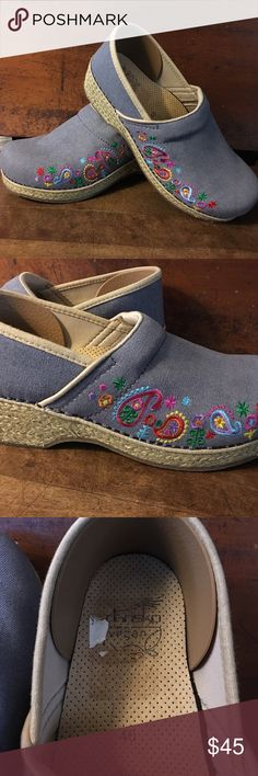 Adorable Vegan Dansko clogs Light blue denim like clogs with sweet embroidered flower accents. Gently worn condition. These are a Re posh. A bit too loose for my foot Dansko Shoes