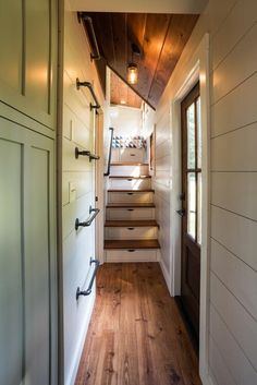 """aquietcottagelife: """"This gorgeous 37′ gooseneck tiny house is the Denali by Timbercraft Tiny Homes. The spacious tiny house includes 23 wood clad windows, two exterior doors, a folding rear porch, and..."""