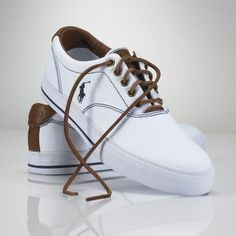 This classic canvas sneaker features smooth leather accents and laces. Double-needle-stitched detail at the upper. Leather laces. Our embroidered pony accents the outer side. Leather-lined.