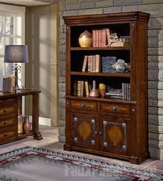 Faux stone wall paneling accents and highlights furniture that anchors the room, like this bookcase