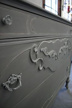 French Linen Annie Sloan Chalk Paint. Then dry brushed Old White over the details
