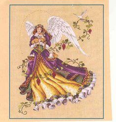 angeles, hadas, sirenas y brujas en punto de cruz (pág. 45) | Aprender manualidades es facilisimo.com