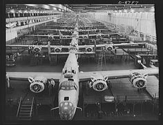 Production. B-24E (Liberator) bombers at Willow Run. Looking up one of the assembly lines at Ford's big Willow Run plant, where B-24E (Liberator) bombers are being made in great numbers.
