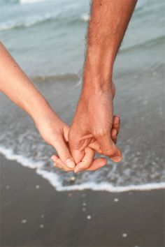 Holding hands and walking along the sea's shore...