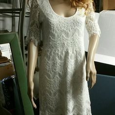 Lace sold out dress from wet seal size large White lace mini dress never worn from wet seal. Too  big now, does run true to size. Large. Beautiful lace detail with fringe @ bottom. Sure to be a hit this summer with some boots, sandals or BAREFEET! Beach side. :) Wet Seal Dresses Mini