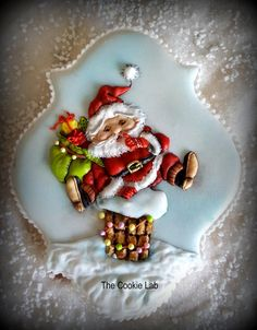 "The Cookie Lab by Marta Torres Coloured Royal icing Decorated Cookie - Not Painted ""Little Santa is ready to Jump down the chimney"" #santa #Christmas #cookie #thecookielabclasses #martatorrescookies #martatorres #royalicing #royalicingart #sugarart  (marina Fedotova inspired)"