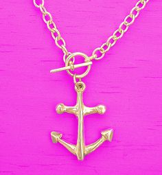 gold anchor on neon pink