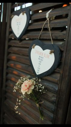 We used slate hearts for our table plan and attached them to a folding screen