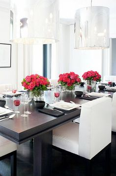 Modern glam dining room with oversized silver pendant lamps and black and white color scheme. #diningroom