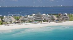Paradisus Cancun Resort & SPA All Inclusive.This beachfront resort offers bright, modern rooms with a private terrace overlooking the Caribbean Sea or Nichupte Lagoon. It is located 25 minutes drive from Cancun International Airport and has some excellen