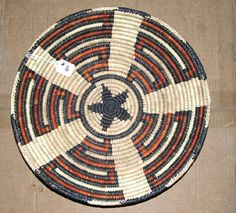 "An expertly handwoven southwestern style basket. Its large 16"" diameter & 3"" depth makes it ideal for a fruit basket or party snacks, but so pretty, you can hang it on your wall.  Just 24.95 #basket #handwoven #southwestern #basketry #fruitbasket"
