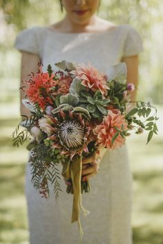 Dahlia and protea bouquet by Mikarla Bauer / Suzanne Harward sequin wedding dress