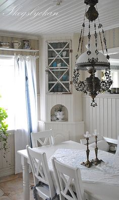 Shabby cottage style...love this light fixture.