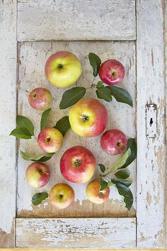 love how the apples make the worn weathered door look pretty...