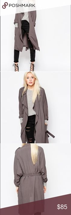 Trench Coat NWT Dark grey trench coat with belt. Brand new with tags attached! Lightweight. The belt loop on the one side is ripped (as seen in the last photo). Can easily be sewn back on!                        •n o  t r a d e s• •s m o k e  f r e e / p e t  f r e e  h o m e•   •s a m e / n e x t  d a y  s h i p p i n g• Asos Jackets & Coats Trench Coats