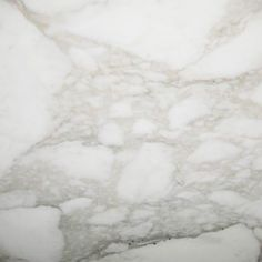 CALCATTA GOLD. Broad veins of grey outlined with gold on an eggshell white background. Beautiful marble color available at Knoxville's Stone Interiors. Showroom located at 3900 Middlebrook Pike, Knoxville, TN. www.knoxstoneinte... FREE Estimates available, call 865-971-5800.