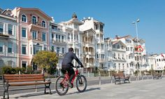 cycling past historic apartments by the Bosphorus in Bebek, Istanbul • article about cycling tours in Istanbul: for the brave! • photo by Korhan Sezer • we often host cyclists at www.istanbulplace.com holiday apartments