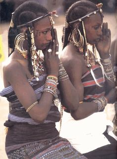 Feigning coyness at the Gerewol festival. Every year Wodaabe men put on a performance for the women. The women look away, then point to the most handsome man. He then must steal her away from her husband in the middle of the night. Consent to ravage? These people truly know romance!