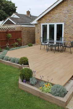 A deck terrace surrounded by planters made with sleepers. Backyard Patio Designs, Backyard Landscaping, Landscaping Ideas, Backyard Ideas, Deck Planters, Back Garden Design, Garden Design Ideas On A Budget, Outdoor Gardens, Sleepers Garden