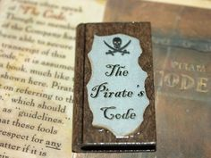 The Pirates Code Miniature Book Pirates of the Caribbean