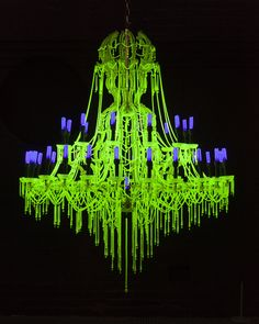 ✨  Julia + Ken Yonetani USA - Uranium Glass Chandelier, part of an installation in response to the 2011 Fukushima nuclear disaster. There are 31 chandeliers, their sizes correspond to the nuclear capacity in a country, with the USA the largest. Densely covered with specially sourced uranium glass beads & crystal pendants. When lit in darkness, the ultraviolet light tubes react with the uranium inside the glass to create a fluorescent green effect, reminiscent of the presence of radiation.