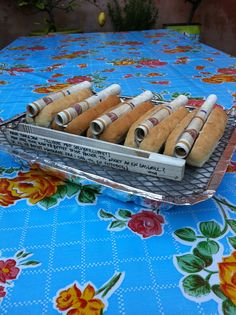 A nice way to give money for a new grill: Moneynotes rolled in a hotdog bread, and instead of a card we wrote on the tong.